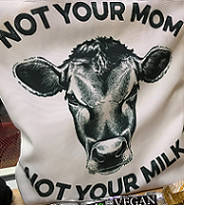 White T-shirt with big cow face in the middle and words Not Your Mom, Not Your Milk