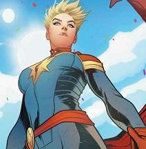 Female superhero comicbook character wearing a tight blue onesie, a red belt, gold epaulets on the shoulders. short blonde hair very spiky against a blue sky with clouds