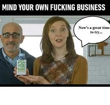 """Bald man with glasses next to a young white woman holding a medicine bottle with a balloon quote saying Now's a great time to try... and at the top the words """"Mind you own fucking business"""""""