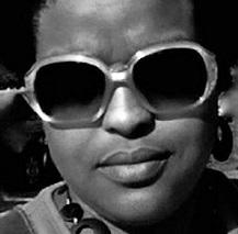 Black woman's face close up, wearing large sunglasses