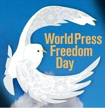 Bright blue background and drawing of white dove with wings encircling the words World Press Freedom Day