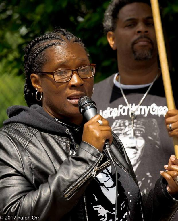Black woman talking into a mic