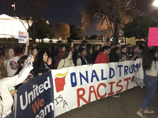 Anti-Trump protest with Trump is racist sign