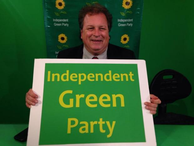 Man holding sign that says Independent Green Party