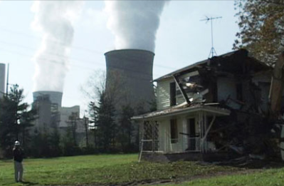 Broken down house and nuclear reactor spewing smoke