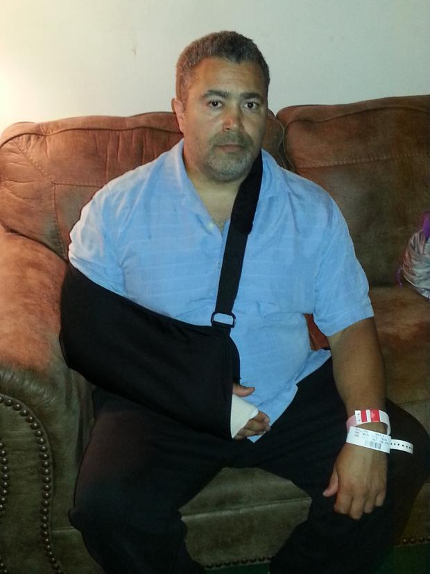 Dale Phillips with arm in sling from tendon injury