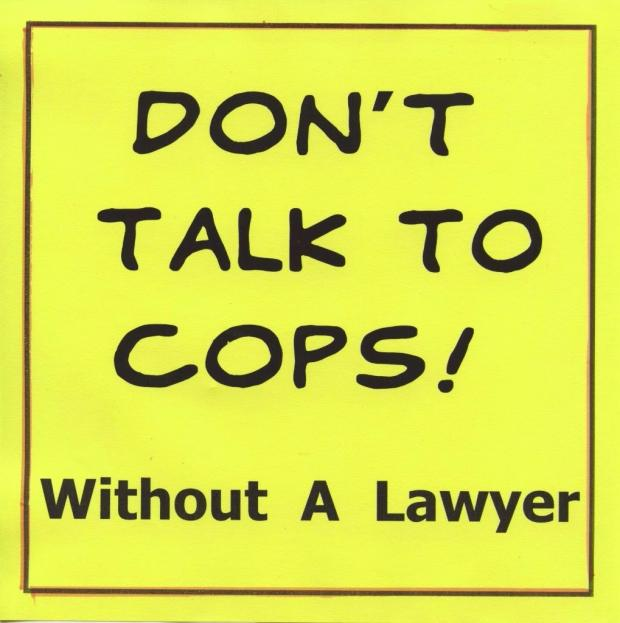"Yellow background with words ""Don't Talk to Cops without a lawyer"""