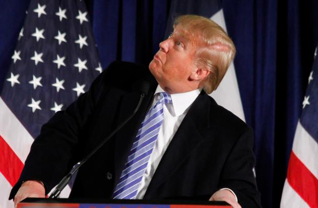 Donald Trump at podium looking sideways and stupid