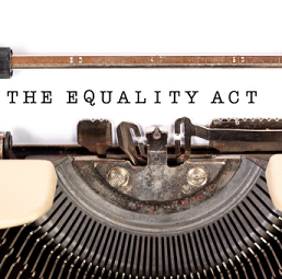 Words Equality Act typed on a paper in a typewriter