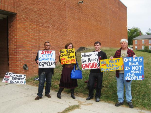 Protesters outside the October 1 public meeting asked: Where is Andrew Ginther?