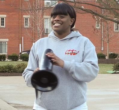 Young black woman with bullhorn outside at rally