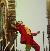 Movie poster from Joker movie with Joker outside leaning back with arms spread wide