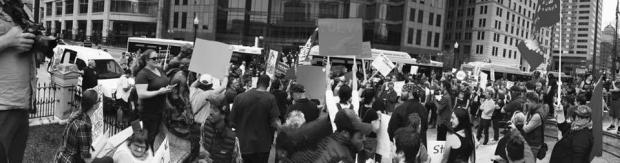 Black and white photo of people holding signs and protesting