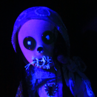 Creepy doll head in blue light