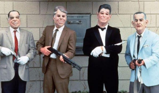 People dressed as presidents in masks with guns
