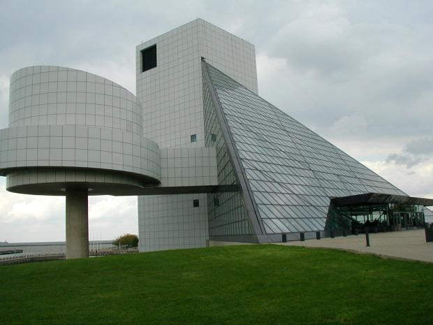 Big concrete structure with roundedness to the buildings and one big triangular side