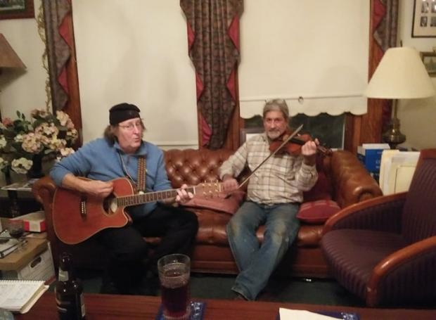 Dan Dougan and Steve Caruso playing instruments