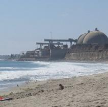 Round topped nuclear plant right on the beach with water coming in
