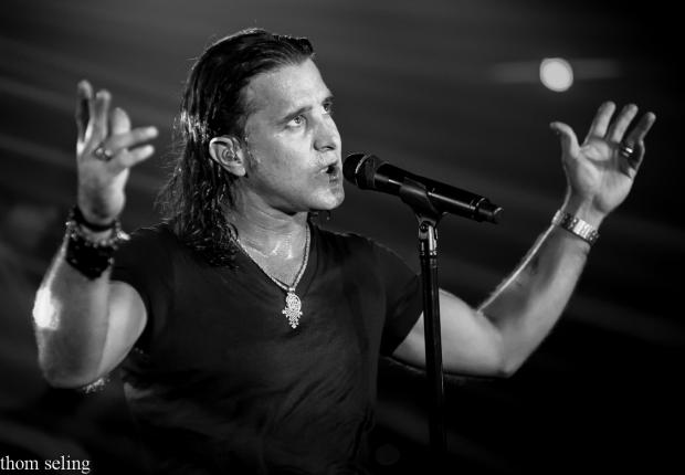 Scott Stapp with arms up singing