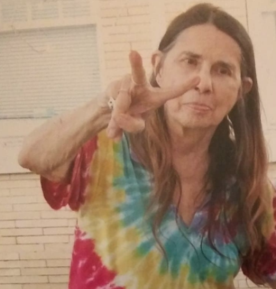 Margaret Sarber making a peace sign