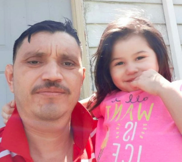 Latino man with little girl
