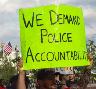 Sign saying We Demand Police Accountability
