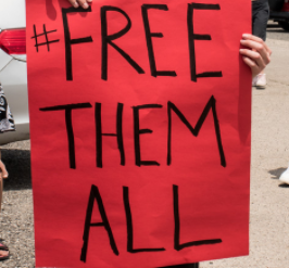 Sign saying Free Them All
