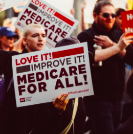 People holding Medicare for all signs