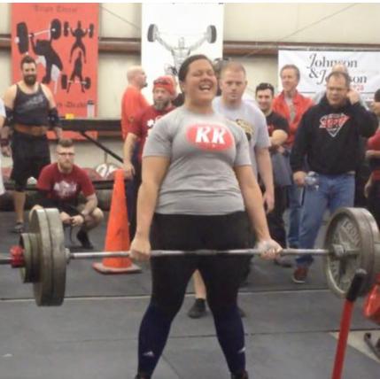 Young woman lifting barbells