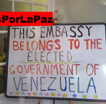 A sign saying This embassy belongs to the elected government of Venezuela