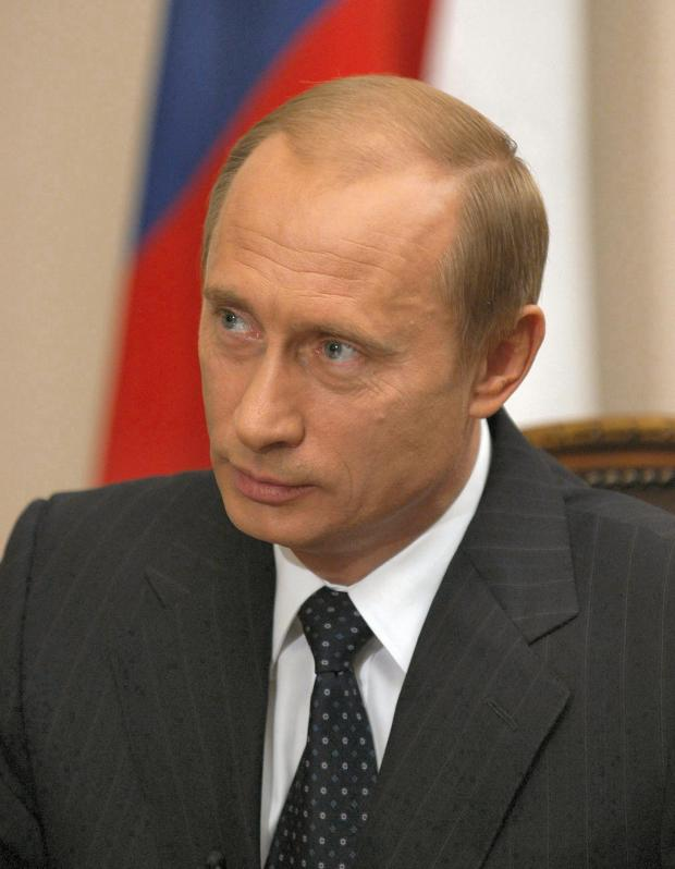 Putin's face, white guy with balding brown hair and a suit