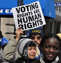 People and sign held high saying Voting Rights are Human Rights