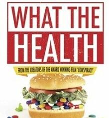 Big hamburger with pills between buns and words What The Health
