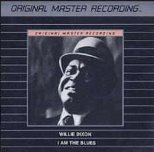 Black album cover with gray thin stripes in the middle there's a black man's face with a bowler hat on at the top it says Original Master Recording then below it says Willie Dixon, I am the Blues