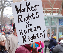 People marching and one closeup of a picket sign reading Worker Rights are Human Rights