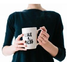 Woman's torso with hands holding mug that says Like a Boss