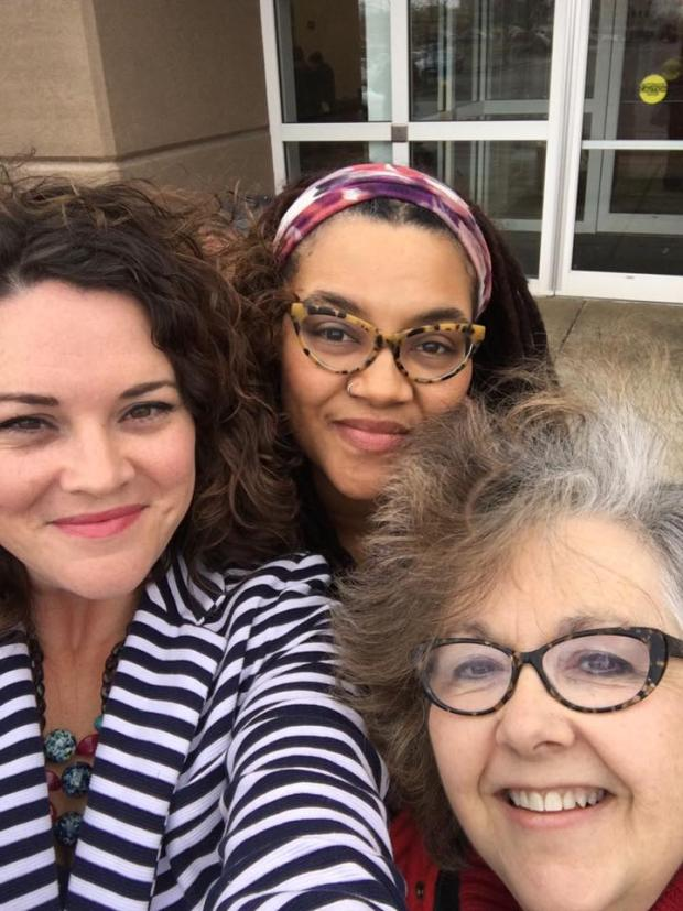 Three women's faces