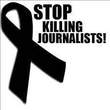 Black ribbon and words Stop Killing Journalists