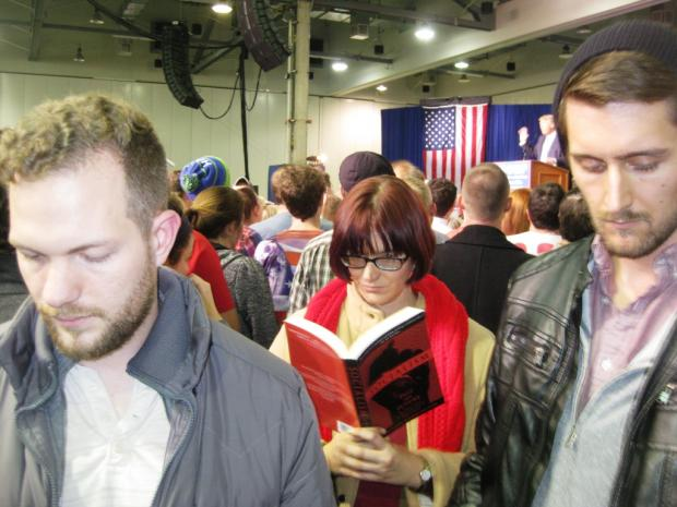 Kyle Landis, Hayley Cotter, and Jordan Patton catch up on their reading while Donald Trump speaks at the Greater Columbus Convention Center.