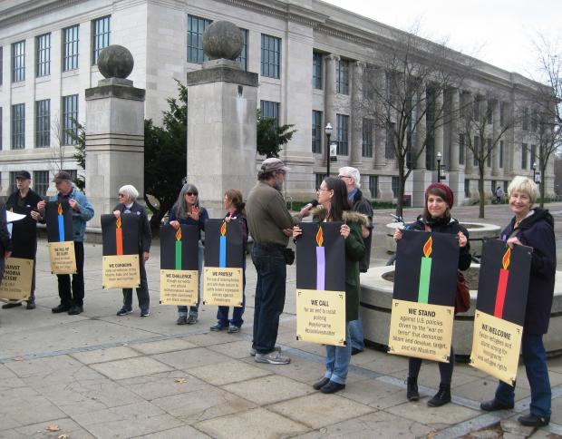 Members of Jewish Voice for Peace hold a symbolic menorah against racism and Islamophobia at the Ohio State University.