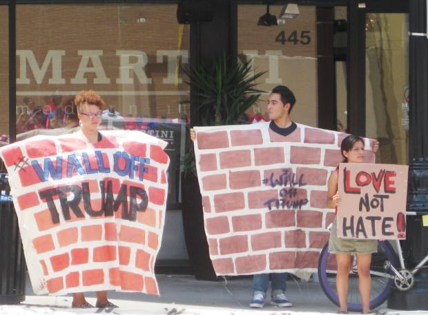 Protesters demontrate across the street from Donald Trump's town hall at the Columbus Convention Center on August 1.