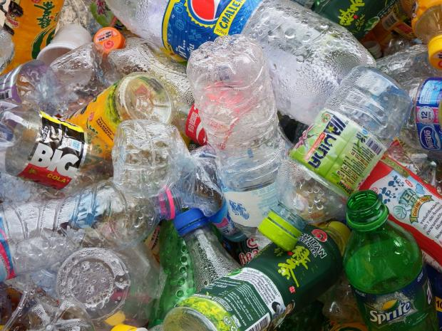 Colorful photo of empty plastic bottles all lying on top of each other in a heap