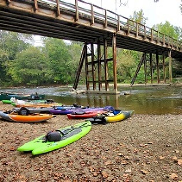 A river, a bridge and several kayaks