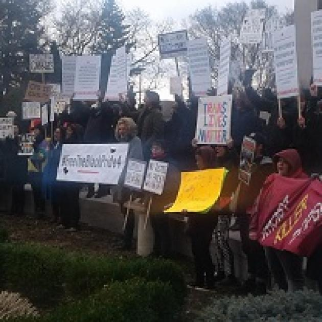 Many people holding signs outside