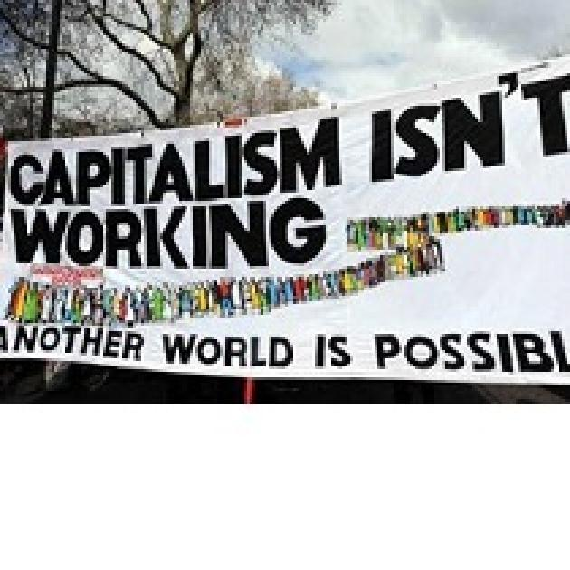 Big banner outside saying Capitalism Isn't Working Another World is Possible