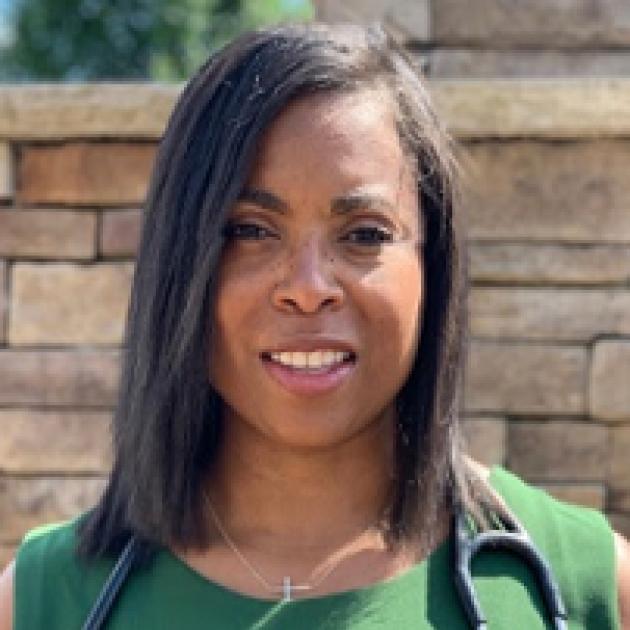 Black woman in green dress