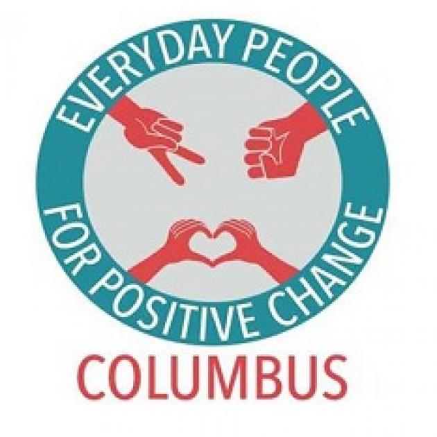 Blue circle with words Everyday People for Positive Change and the word Columbus at the bottom, red hands in the circle with peace sign, fist and making a heart