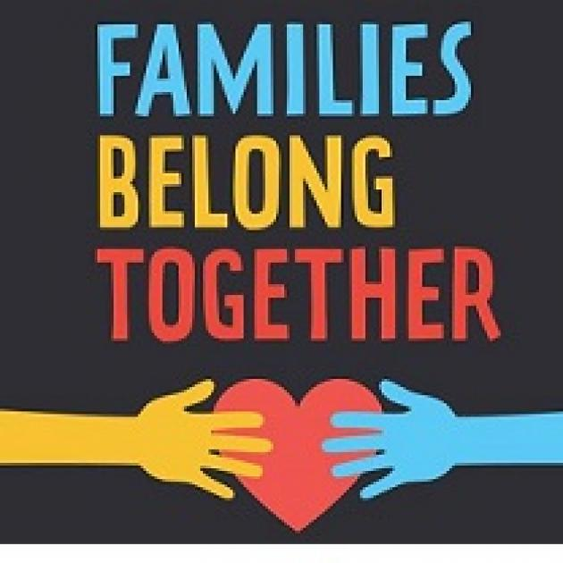 Black background with a yellow hand coming from the left and a blue hand from the right holding a red heart in the middle and the words Families Belong Together
