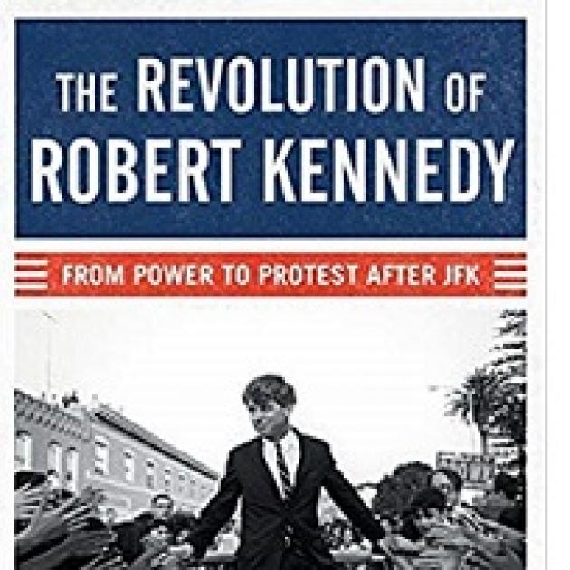 Book cover that's red white and blue with a black and white photo of Robert Kennedy as a young man in a suit walking through a crowd on both sides of a street and the book title at top and the words From Power to Protest After JFK