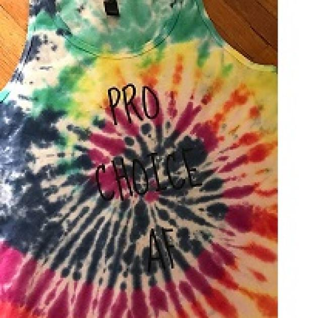 Sleeveless T-shirt with colorful tie-dye pattern in a spiral and the words Pro choice AF